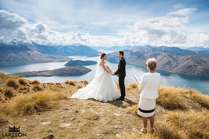 bride and groom exchanging vows on Coromandel Peak. Wanaka New Zealand