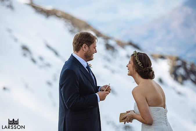 exchanging vows. Destination heli wedding Queenstown