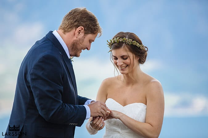 exchanging rings. Destination heli wedding Queenstown