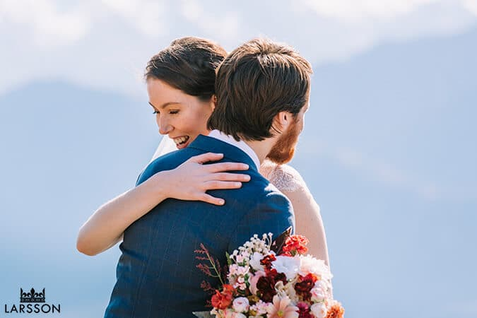 Wedding couple hugging in the mountain