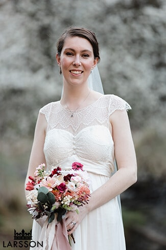 Bride with white spring blossom at Queenstown wedding