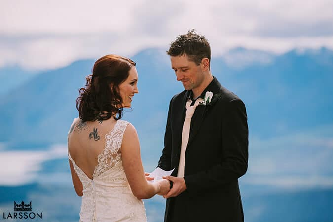 Bride and Groom exchanging vows. Destination Heli weddings Wanaka