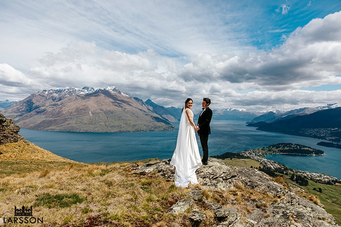 Bride and groom on the mountain on a sunny day in Queenstown ,New Zealand destination wedding