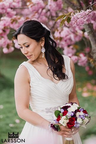 Bride with spring blossoms in New Zealand