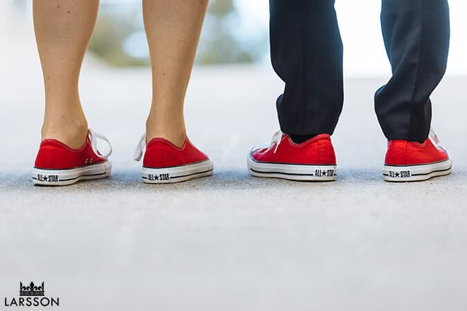bride and groom wear matching red converse wedding shoes