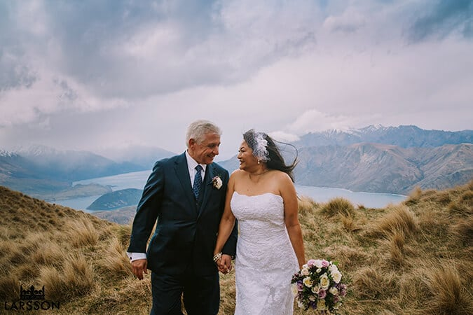 Bride and groom brave the cold on top of Coromandel peak during Destination Heli wedding Wanaka