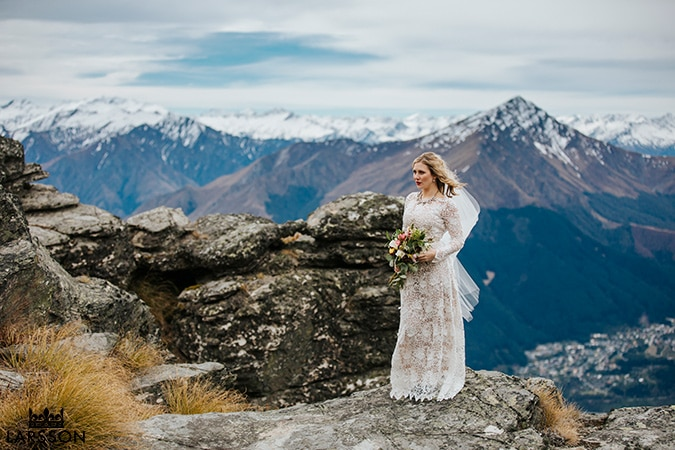 Bride on a mountain on a moody and stormy day, Queenstown Wedding