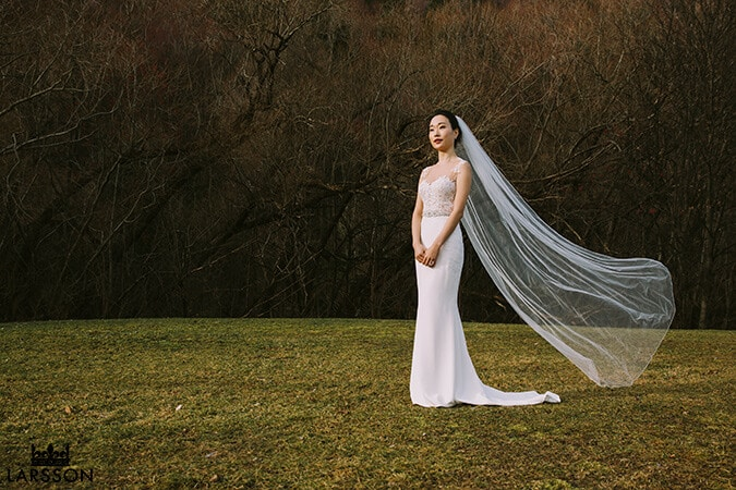 Brides veil flies in the wind during wedding photography