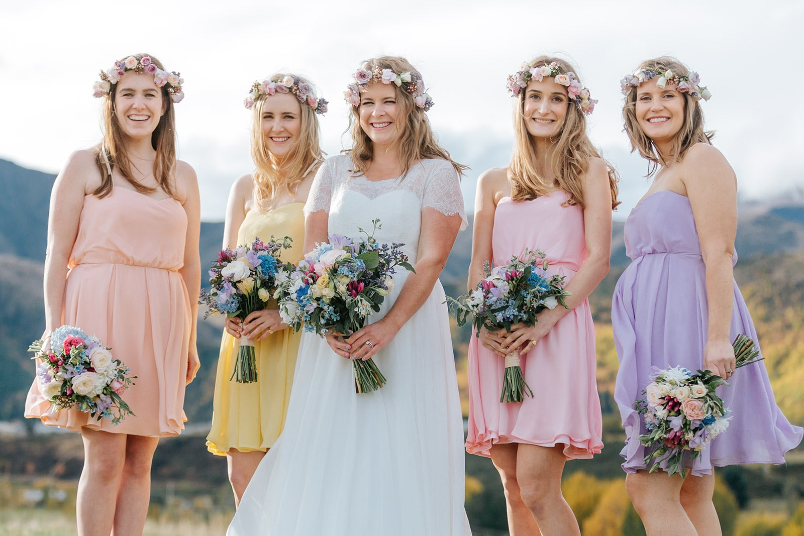 colourful bridesmaids with flower crowns at Queenstown wedding