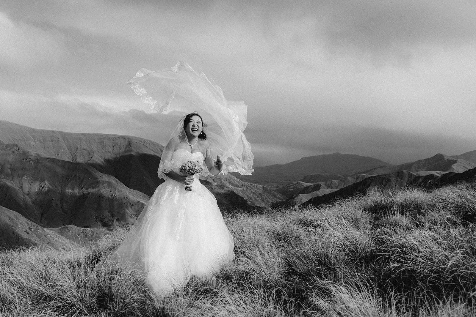 Bride on mountain with floating veil at Queenstown Wedding photography